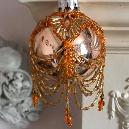Orange swags and tails bauble