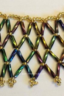 Netted necklace made with rainboe bugle beads and gold seed beads.