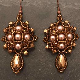 Demeter earrings made form gold pearls and gold metallic crystals.