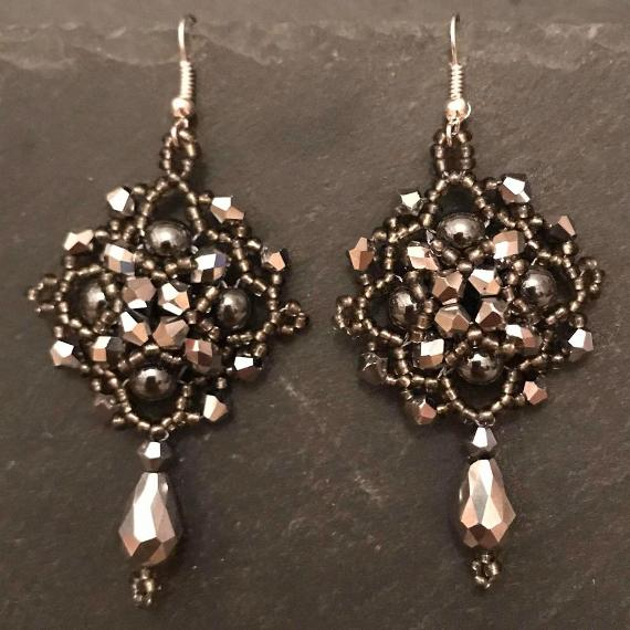 Persephone earrings made with silver crystals and grey beads.