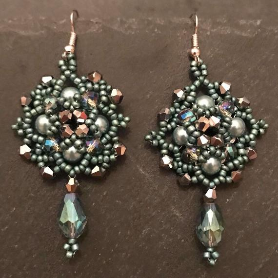 Persephone earrings made in sage green pearls with silver crystals.