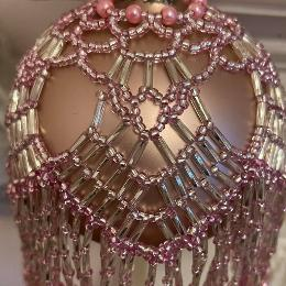 Chandelier bauble. Pink and silver beads on a pink Christmas tree ornament.